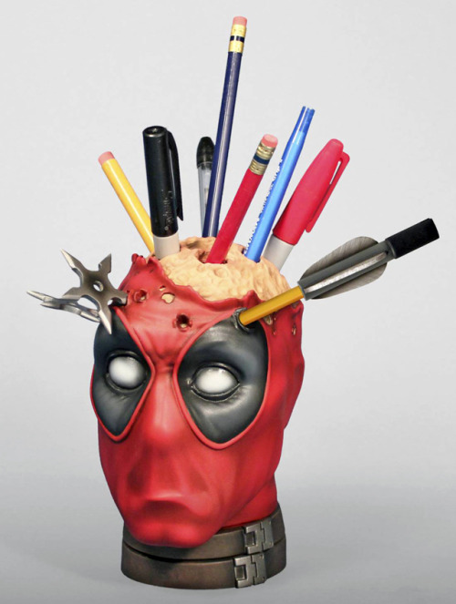 gttrmgc:  laughingsquid:  Deadpool Pencil Holder Desk Accessory  Gimme.