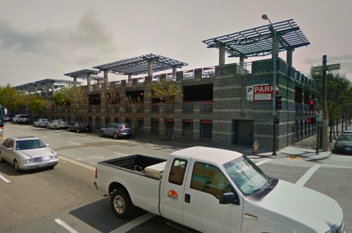 I like how in SF they try to make the parking garages look like buildings. it's not as unpleasant to walk by as opposed to surface parking lots or typical parking garages. 11th/harrison. there's another that's even better that i passed by on Nob Hill, with stores on the first level, but I don't remember the cross-streets. would be even better if those were solar panels on top.