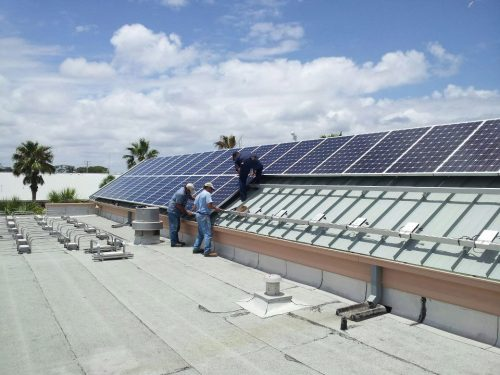 Neptune Beach, Florida is saving big with solar panels partially funded by the Energy Department. The 140 rooftop panels have resulted in their City Hall having no monthly electricity bill and securing a credit of $176 from their utility for excess power sold back to the grid. Based on the project's success, the city is exploring opportunities for additional solar installations. Read more about DOE's Energy Efficiency and Conservation Block Grant Program that helped fund this project here: http://go.usa.gov/TUCz. Pictured is the solar being installed late last year.