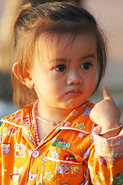 quietbystander:  DSC_4758 by ichauvel on Flickr. Cambodian cutie pie