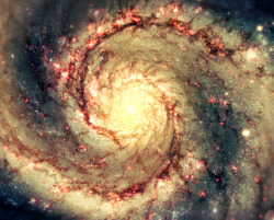 APOD 2013 February 24 M51: The Whirlpool Galaxy in Dust and Stars  Image Credit:  N. Scoville (Caltech), T. Rector (U. Alaska, NOAO) et al., Hubble Heritage Team, NASA  Explanation:  The Whirlpool Galaxy is a classic spiral galaxy. At only 30 million light years distant and fully 60 thousand light years across, M51, also known as NGC 5194, is one of the brightest and most picturesque galaxies on the sky. The aboveimage is a digital combination of a ground-based image from the 0.9-meter telescope at Kitt Peak National Observatory and a space-based image from the Hubble Space Telescope highlighting sharp features normally too red to be seen. Anyone with a good pair of binoculars, however, can see this Whirlpool toward the constellation of the Hunting Dogs (Canes Venatici. M51 is a spiral galaxy of type Sc and is the dominant member of a whole group of galaxies. Astronomers speculate that M51's spiral structure is primarily due to its gravitational interaction with a smaller galaxy just off the top of the image.