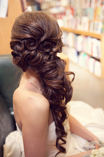 Wedding Hairstyle- On the Romantic Side - hair that is styled to the side creates a very sweet and romantic look.