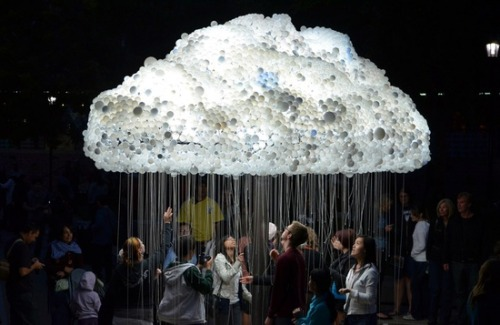thechocolatebrigade:  Cloud made from 6,000 light-bulbs, life-sized interactive light installation engaging the public to participate by standing beneath the structure and pulling lights on and off, creating the flickering aesthetic of an electrical cloud - conceived by Caitlind Brown, part of the Nuit-blanche all-night contemporary arts festival in Calgary, Canada