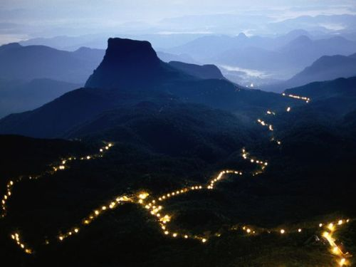commovente:  Sri Lanka, Photograph by Greg Elms A long line of lights illuminates the path to the summit of Adam's Peak during the Poya Festival in the Central Highlands of Sri Lanka.