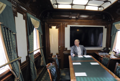 Russia's President Vladimir Putin pauses in his railway car before a meeting on the development of railways and railway service in Moscow on October 19, 2012. by Alexey Druzhinin