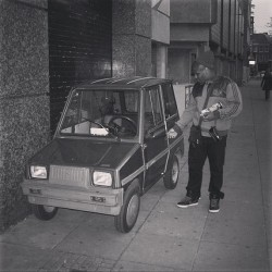 #small #petite #car #tiny #little #city #streets #daytime #black #white #photography
