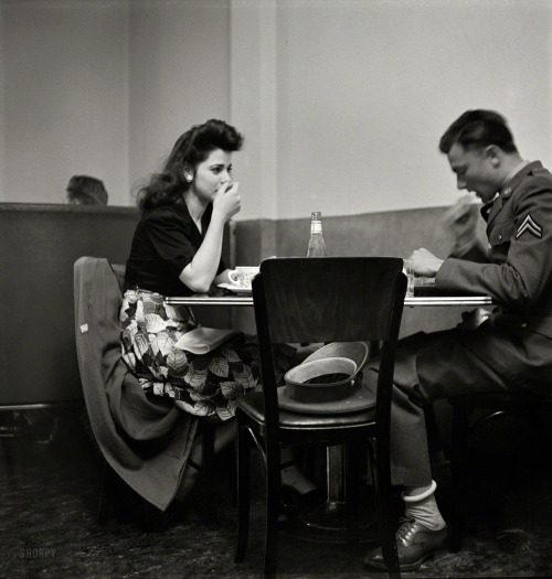 "shorpyfan:  May 1942. ""A corporal in the Army takes his girl to dinner. Bakersfield, California."" Photo by Russell Lee, Office of War Information."