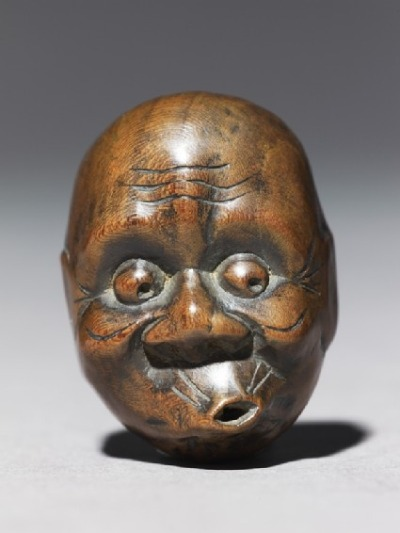 browndresswithwhitedots:  Netsuke in the form of a hyottoko mask, 18th century