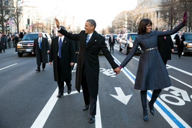 President Barack Obama and First Lady Michelle Obama wave to the crowd as they walk in the inaugural parade along Pennsylvania Avenue in Washington, D.C., Jan. 21, 2013. (Official White House Photo by Pete Souza)