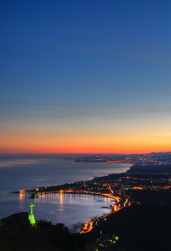 travelingcolors:  Giardini Naxos bay at sunset in Taormina, Sicily | Italy (by Giuseppe Finocchiaro)