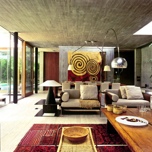 Dining table designed by ACF Arostegui Camblong Falconi, rug on the wall is the American Alexander Calder's works, carpeting is made ​​from old camel bags from Baktiar tribe