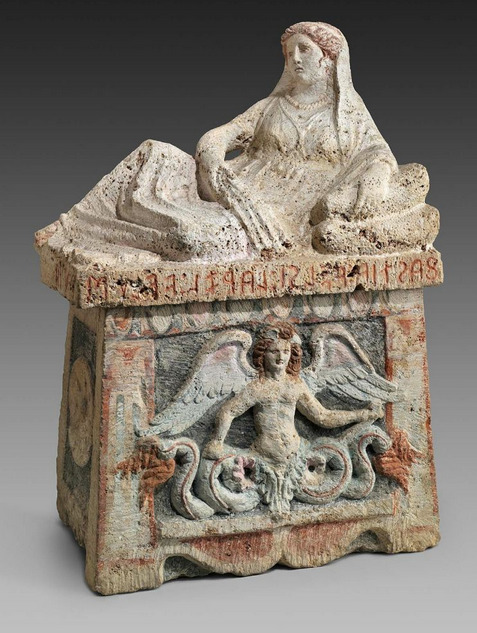 "Limestone Etruscan funerary urn, 104 x 75 cm, late 3rd century B.C, Italy. This object is one of five ash urns found in a tomb of the Velsi family of ancient Chiusi. This urn is the largest and best preserved of the group. Its inscription, ""FASTIA VELSI LARZL, VELUS PUIA,"" which extends across the front and part of the left end of the lid, identifies the cremated remains as those of ""Fastia Velsi, wife of Larza Velu."" - mfa.org"