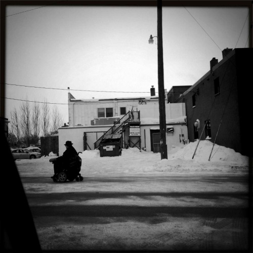 """Road Warrior""   For your daily dose of Hipstamatic this image of a man in his wheel chair rolling down the back streets of Fargo, North Dakota. Hipstamatic 261, John S lens, Black Keys Film, No flash Visit my blog at http://www.hipstamaticpics.com"