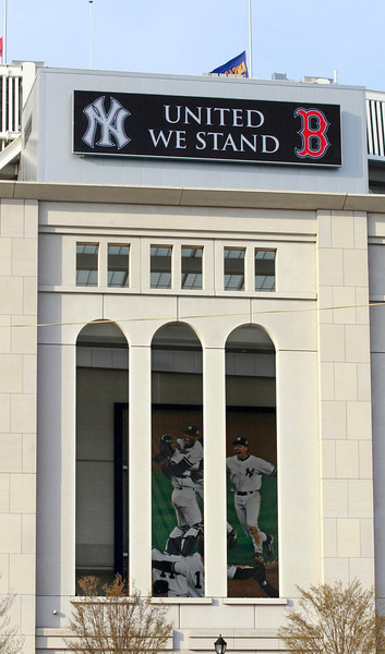 A New York Yankees sign showing solidarity with arch-rival Boston Red Sox, after the April 15 Boston Marathon bombings, is seen outside of Yankee Stadium on April 16, 2013. (Ray Stubblebine via Photos: Sports Day In Pictures)