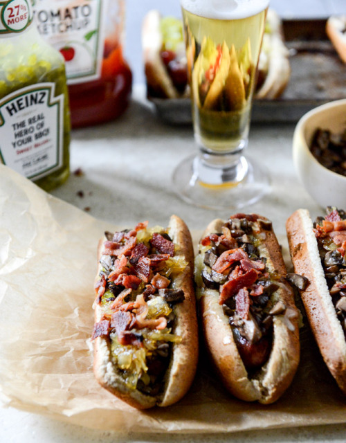 gastrogirl:  loaded cheddar hot dogs with honey caramelized onions, garlic mushrooms, and bacon.