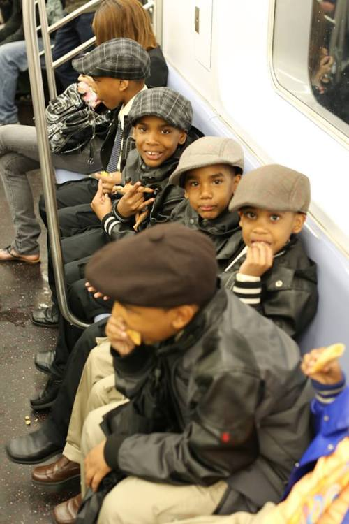 humansofnewyork:  Seen on the subway.  The love affair with public transportation starts at an early age.. Gotta love that!