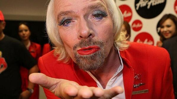 Richard Branson - This photo of Richard Branson dressed as a female flight attendant blowing a kiss