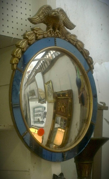 "This mirror is definitely for the Federalist at heart.  I scoped this gem on a recent trip upstate (they always have good stuff) and began to covet it.  Now you may say ""Samiayah, what in the world would I do with this mirror?"".  To which I'd say, just about anything.  For instance, you can go full ""period style"" and place it in your entry way with a fantastic Federal style bench.  Or if you're feeling more eclectic, like me, try one with a little more visual punch with animal print or a graphic pattern.  You can also place the mirror as the centerpiece to a vintage mirror installation.  But, if you're feeling really fun, give your guest a little taste of the funhouse and mount it in the powder room.  It would probably guarantee that they won't be in there for too long.  Interesting and fun design is only limited by a limited imagination.  So have a great time with it!"