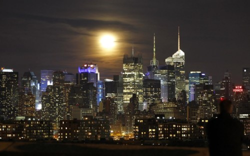 The Moon rises above the Manhattan skyline.  (Photo: Gary Herzhorn / Reuters via The Telegraph)