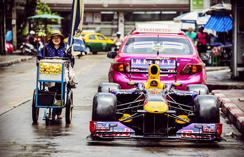 fuckyeahf1drivers:  A Red Bull RB6 parked on the street in Bangkok