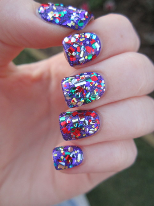 reneesnails:  Glitter bomb for my newly cut nails :( This is Face of Australia's Saturday Night Fever over Nubar's Violet Sparkle. More nails.