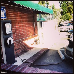Incase you don't know what this is, it's an electric car outlet in a parking lot charging a car. The earth needs A LOT more of this! #BeGreen
