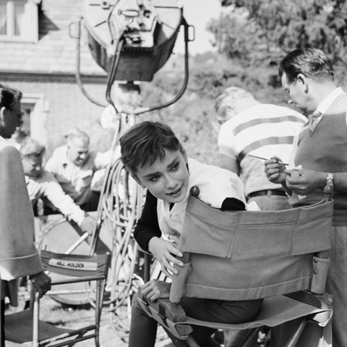 theniftyfifties:  Audrey Hepburn on set, photographed by Mark Shaw.
