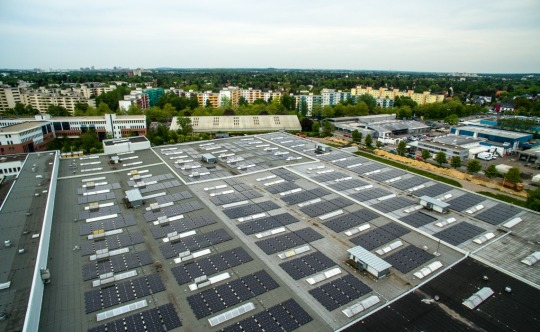 Above and below: Solar panel's covering the roof of a GE plant in Berlin, Germany. They supply electricity to the company first hybrid power plant.