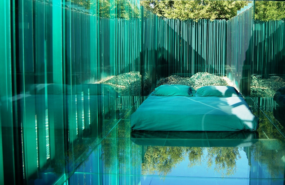 "luxuryaccommodations:  Les Cols Pavellons - Olot, Spain Situated in the small Catalan town of Olot, next to the volcanic Garrotxa National Park, Les Cols Pavellons could easily be considered one of the most unusual accommodations in Spain. The property consists of a Michelin-starred restaurant housed in a 13th century farmhouse and 5 glass-and-steel pavilions designed by the skillful architects of RCR-Aranda-Vilalta-Pigem studio. Each ""room"" looks like a crystal cube with glass floors and is completely deprived of interior decorations and technology, ensuring guests a unique, almost surreal accommodation experience."