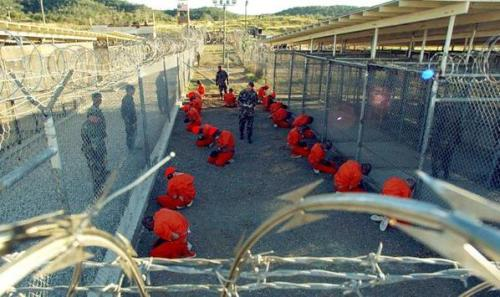 "anarcho-queer:  Guantanamo Guards Fire At Hunger Striking Detainees Military guards at Guantanamo's communal camp fired four 'non-lethal' rounds at detainees early Saturday morning as the facility commander forced them into single cells in an apparent effort to stop a prolonged hunger strike. Currently, 43 detainees are on a hunger strike at the prison; 13 of those are being force fed. Guards forced detainees from communal areas to individual cells at 5:10 a.m. EDT on Saturday, said a Department of Defense news release. The action was taken ""in response to efforts by detainees to limit the guard force's ability to observe the detainees by covering surveillance cameras, windows, and glass partitions."" Four non-lethal rounds were fired after some of the detainees used ""improvised weapons,"" to resist being moved, according to the military. No guards or detainees were seriously injured. The military said that more than 40 detainees are participating in the hunger strike, which began in February, but detainees have told their lawyers the strike is much more widespread and involves the vast majority of the 166 detainees remaining at Guantanamo."