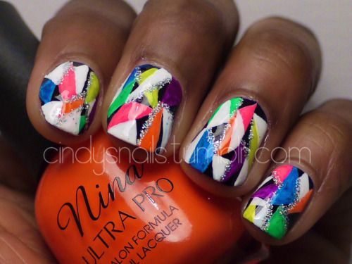 Neon geometric nail design with holographic glitter!