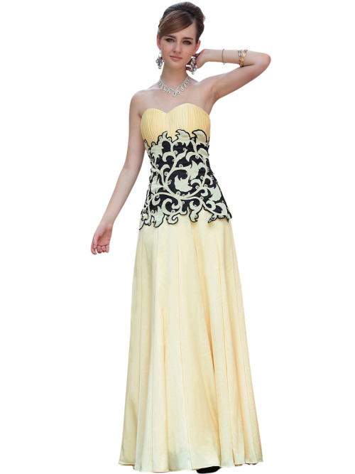 TRISH IN YELLOW PLEATED EVENING DRESS W/ BLACK DETAILS  SKU# 30618 Be the first to review this product Availability: In stock £247.00