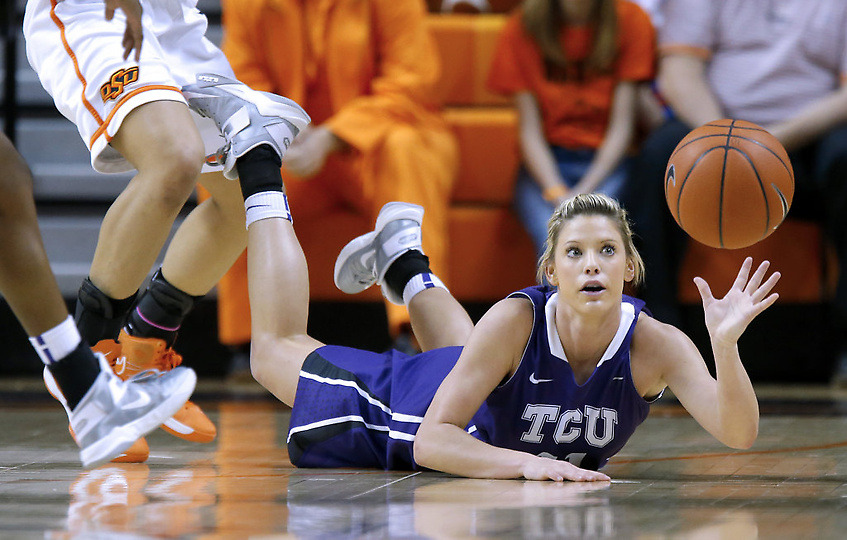 TCU's Kamy Cole (11) dives for the ball during an NCAA college basketball game against Oklahoma State in Stillwater, Okla., Tuesday, Feb. 5, 2013. (Bryan Terry via Sports Day in Pictures)
