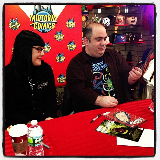 Dan Slott and Stephanie Buscema signing Spidey #700