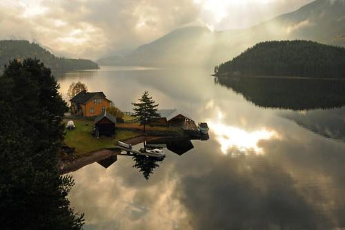 Telemark, Norway. Find me a sweet little hut on the edge of a silent lake.
