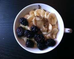 offmyplate:  Banana! Oh and there's cinnamon oatmeal under there too.  Topped with lightly melted blackberries and sunflower seed butter.  Disclaimer: not all sunbutter used in this creation shown in photo
