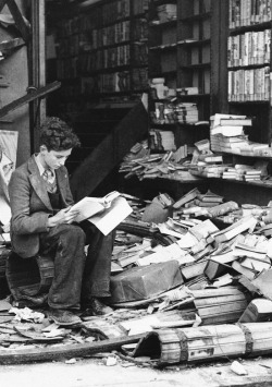 ev-anouir:  1940, A boy sits amid the ruins of a London bookshop following an air raid on October 8, 1940, reading a book.