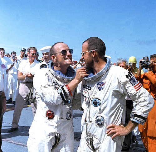 manofthemmnt:  Astronaut Charles Conrad Jr. tweaks Astronaut L. Gordon Cooper's eight-day growth of beard for the cameramen while onboard the prime recovery vessel after their Gemini 5 flight. Man of The Moment