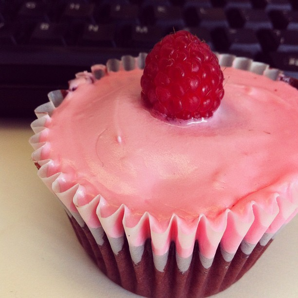 Oh of the cutest red velvet #cupcakes I have received at work. And yes, it is supposed to look a little like a boob ☺#opentext #work #officetreats #raspberry