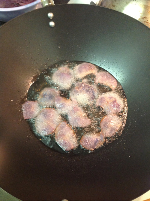 Frying up some local purple potato chips.