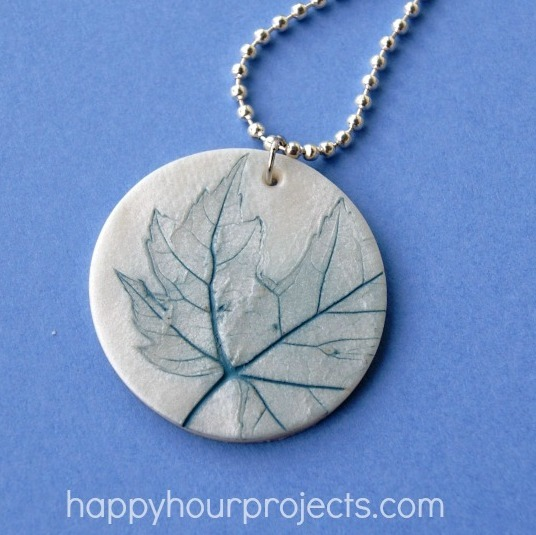 truebluemeandyou:  DIY Easy Polymer Clay Leaf Imprinted Pendant from Happy Hour Projects here. What is great about polymer clay is you can imprint any texture you want on it, bake it, and then rub on and off a little paint/stain to get really interesting designs. *As always nothing that touches polymer clay can come in contact with food again. For more polymer clay DIYs like the cake ring go here: truebluemeandyou.tumblr.com/tagged/polymer-clay