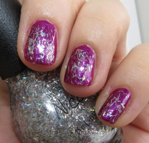 "Selena Gomez' ""Pretty In Plum"" with ""Stars at Night"" on top, from her Nicole by OPI Nail Polish Collection!"