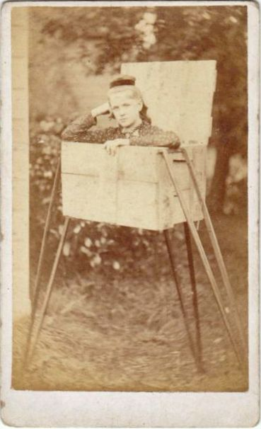 ca. 1870-90's, [carte de visite portrait of a woman, possible a contortionist, in an elevated box] via Ebay