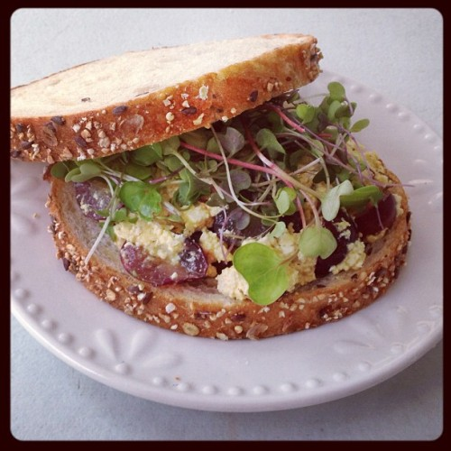"Today's delicious lunch post. ""Better than chicken salad"" sandwich on whole grain bread with microgreens.(I grew those microgreens myself)."