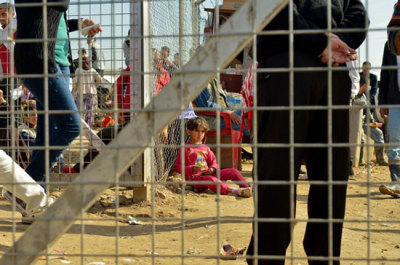 Photo: A little girl waits against the gates of the camp registration center in Domeez. Iraq 2013 © Pierre-Yves Bernard/MSF Providing Care in Syria and in Neighboring Countries: An Overview of MSF programs in and around Syria The conflict in Syria remains extremely intense. Frontlines continue to shift. The medical system is in shambles. An estimated 6.8 million people are in urgent need of humanitarian aid, but whole enclaves are cut off from assistance of any kind. Despite the very real challenges of operating in the country, MSF is now running four hospitals inside Syria and is increasing mobile clinic activities to the extent possible. Simultaneously, the organization is actively seeking to open new projects where it is safe to do so. And, it should be noted, MSF is using only private donations for its work in Syria in order to remain entirely independent of all political positioning around the crisis. MSF is also working in the neighboring countries of Iraq, Jordan, Lebanon, and Turkey, where some 1.4 million Syrians have fled in search of sanctuary. These countries have been overwhelmed by the influx of refugees and returnees, and the humanitarian response has thus far been unable to meet their needs.