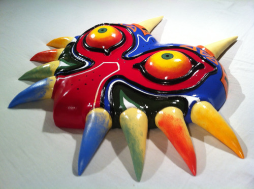 prince-derp:  guru—guru:  iheartnintendomucho:  Majora's Mask replica by Tobias Lundgaard Larsen It took Tobias 8 months to make this beauty. Could you sleep with one of these looking you in face at night? I think I could. If it wasn't such a lovely wall ornament, I may even see myself wearing it around in public while I cause mischief/try to make the moon crash into earth.  Check out Tobias's other work here! Follow for more Nintendo news, reviews, art and gifs! Buy Hyrule Historia 20.00   aaaand bought