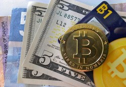 "BEWARE THE BITCOIN? Online currency system Bitcoin was launched January 3rd, 2009 by an unknown Japanese programmer to little fanfare. Calling himself Satoshi Nakamoto, the programmer disappeared from the web altogether in 2011. As the service has grown in popularity, experts have claimed the world-class work of the Bitcoin system was likely the invention of a team of people with a ""deep understanding of programming language, economics, cryptography, and peer-to-peer networking"" or possibly a solitary genius."