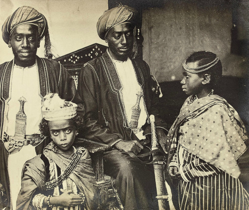 antisquared:   The Island of Zanzibar  19th century photo of the English traveler Sir John Kirk showing a daughter and son of the Sultan of Zanzibar protected by two guards  Word