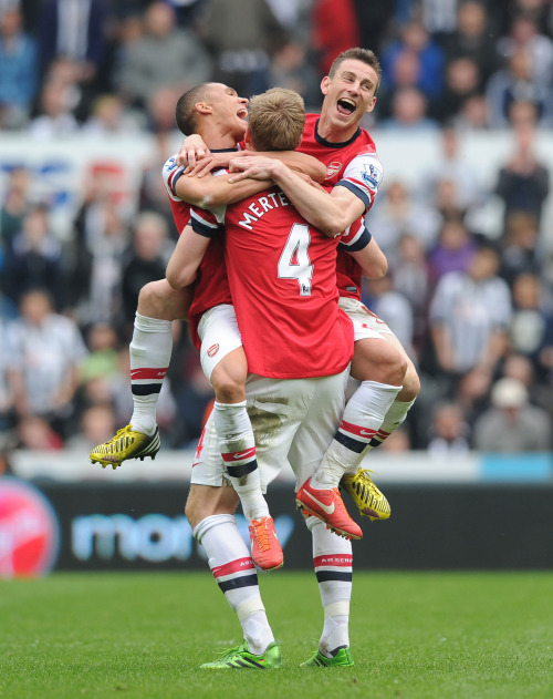 NEWCASTLE UPON TYNE, ENGLAND - MAY 19: (L-R) Kieran Gibbs, Per Mertesacker and Laurent Koscielny celebrate celebrate the Arsenal victory after the Barclays Premier League match between Newcastle United and Arsenal at St James' Park on May 19, 2013 in Newcastle upon Tyne, England. (Photo by Stuart MacFarlane/Arsenal FC via Getty Images)