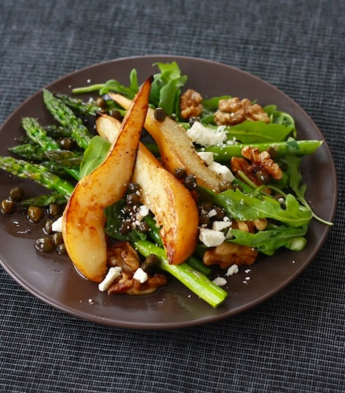 "healthy-salad-recipes:  Caramelized Pear & Asparagus Salad with Caper Vinaigrette Ingredients: 2 firm Bosc pears – cored and cut into 1/2"" inch wedges One bundle of asparagus (about 1 1/2 pound) – trimmed A handful of walnuts 2 tbps olive oil Fresh arugula leaves Crumbled feta cheese or goat cheese Caper Vinaigrette: 1/3 cup olive oil 2 tsp balsamic vinegar 2 tbsp capers Dash of cayenne pepper Salt & freshly ground black pepper to taste Click HERE for the full recipe."